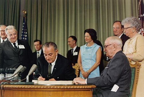 President Johnson signs the Social Security Act of 1965