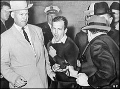 Jack Ruby with gun pointed at Oswald
